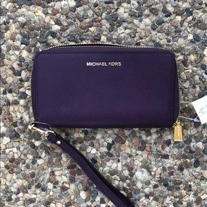 NWT Michael Joes dark purple wallet wristlet